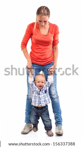Baby boy learning to walk with mother's help over white - stock photo