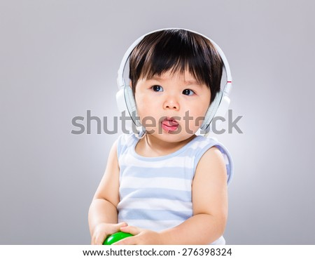 Baby boy listen to music with headphone
