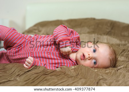 baby boy lying on bad - stock photo