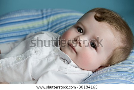baby boy lying on pillow - stock photo