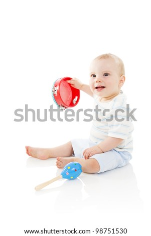Baby boy (8 months old) shaking a tambourine, isolated on a white background. - stock photo
