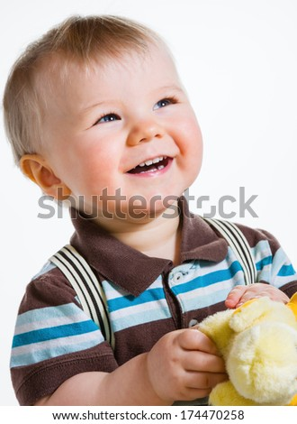 Baby boy, 16 Months old wearing striped shirt and suspenders, white background