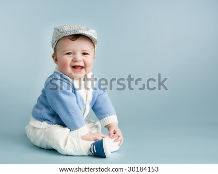 baby boy on blue smiling - stock photo