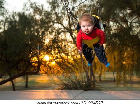 Baby Boy on Swing Looking at Camera