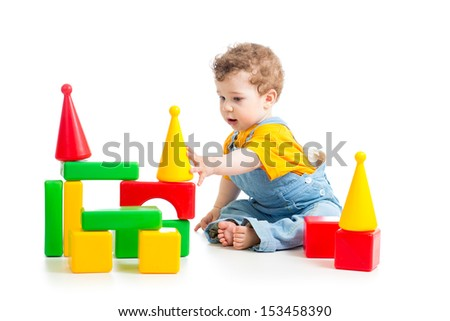 baby boy playing building blocks - stock photo