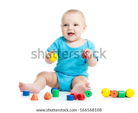 baby boy playing toy blocks  isolated on white background