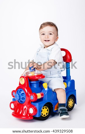 baby boy playing with a toy truck - stock photo