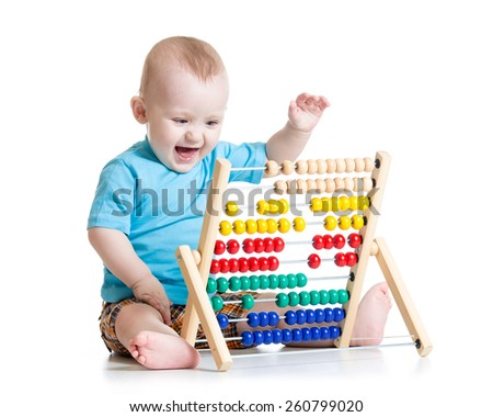 Baby boy playing with abacus toy isolated on white