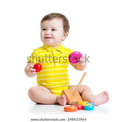 baby boy playing with colorful toy pyramid isolated - stock photo