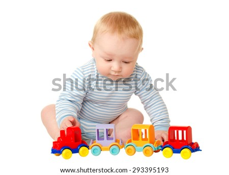 baby boy playing with toy train isolated on white background
