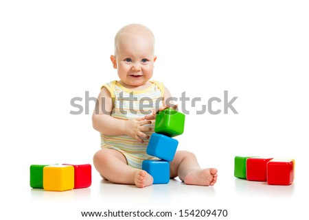 baby boy plays with building blocks - stock photo