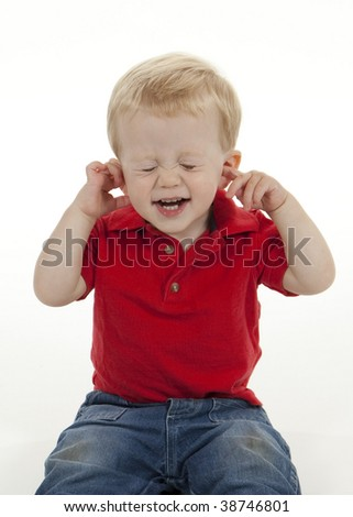 Baby Boy Plugging His Ears and Closing His Eyes - stock photo