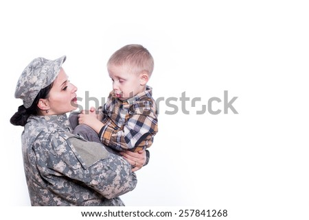 Baby boy sad because his mom soldier is leaving to war - stock photo