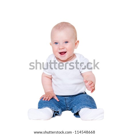 baby boy sitting on white floor and smiling - stock photo