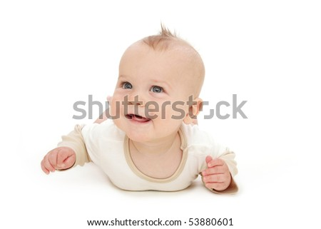 Baby boy smiling, tummy time, on white background - stock photo
