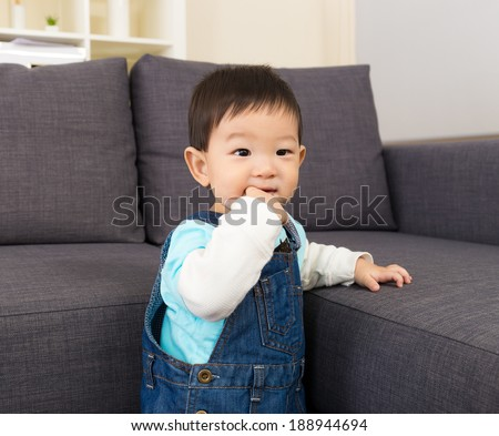 Baby boy suck finger - stock photo