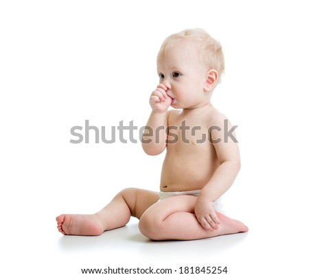 Baby boy suckling thumb isolated on white - stock photo