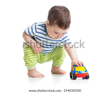baby boy toddler playing with toy car - stock photo