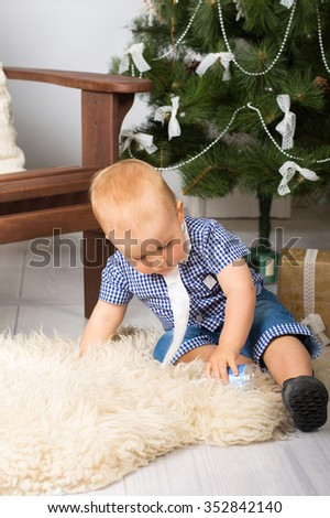 Baby boy under the Christmas tree