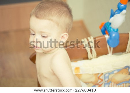 Baby boy waving hand and standing up in crib