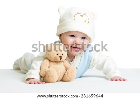 baby boy weared funny hat with plush toy - stock photo