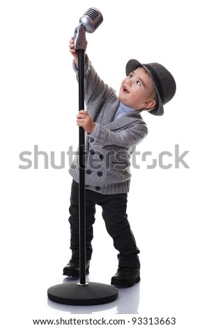 Baby boy with a microphone. - stock photo