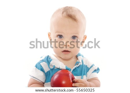 Baby boy with apple on white background - stock photo