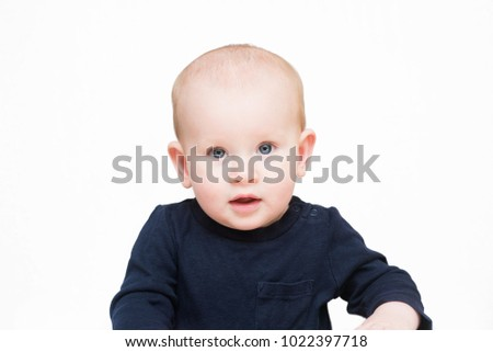 Baby boy with blue eyes on an isolated background