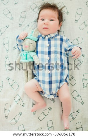 baby boy with bunny toy