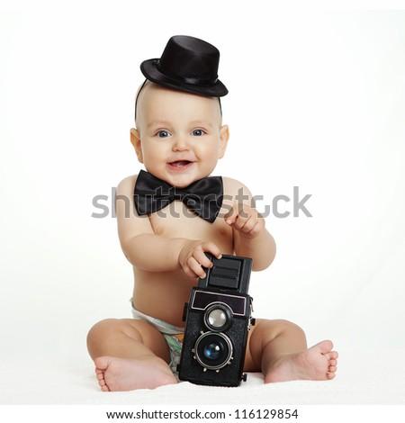 Baby boy with camera - stock photo