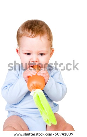 Baby boy with carrot