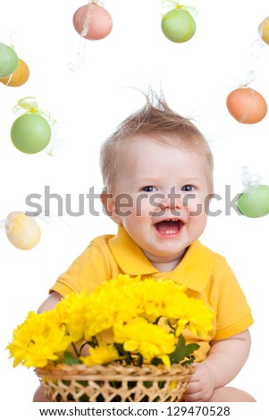baby boy with flowers and Easter eggs - stock photo
