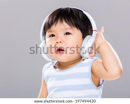 Baby boy with headphone - stock photo