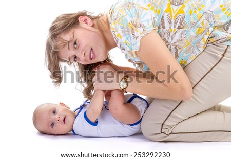 Baby boy with his mother. new born kid and family concept. - stock photo