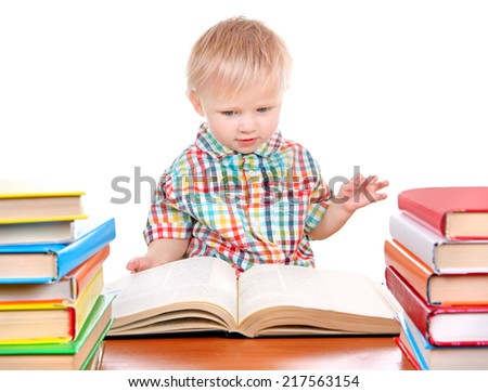 Baby Boy with the Books at the Desk Isolated on the White Background - stock photo