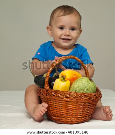 baby boy with vegetables