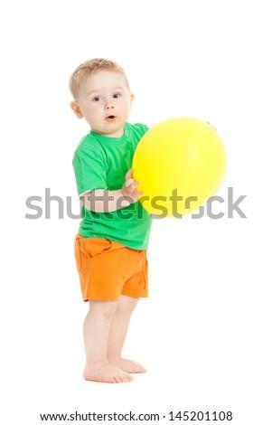 baby boy with yellow ballon - stock photo