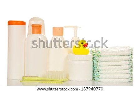 Baby care objects. Olive, shampoo, diapers isolated on white - stock photo