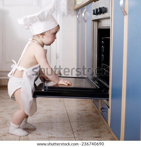 baby chef cooks in the oven food - stock photo