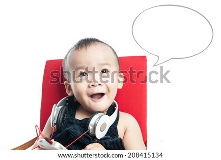 baby child listening to music on ear buds singing - stock photo