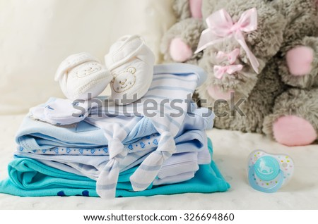 Baby clothes for newborn. In pastel colors - stock photo