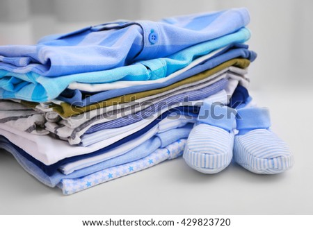 Baby clothes for newborn on white table