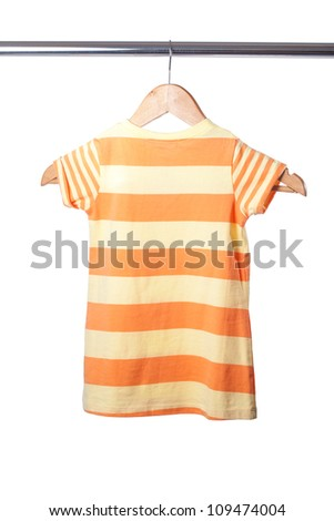 Baby clothes hanger with shirt isolated on white - stock photo