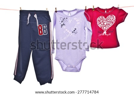 baby clothes on the wire for drying - stock photo