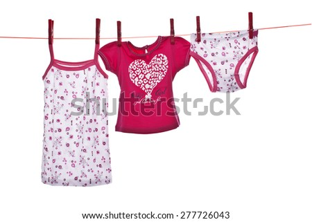 baby clothes on the wire for drying