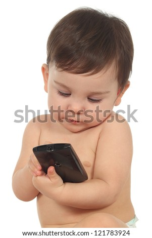 Baby concentrated in a mobile phone with a white isolated background