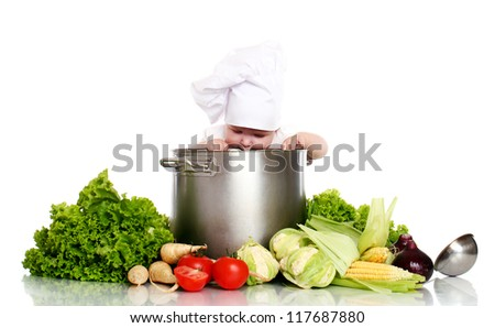 Baby cook looking in pan and vegetables around isolated on a white - stock photo