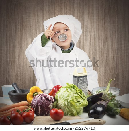 Baby cook tastes the flavor of recipe - stock photo