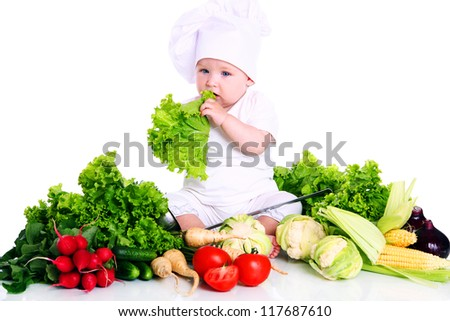 Baby cook with fresh vegetables isolated on a white - stock photo