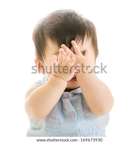 Baby covering eye - stock photo